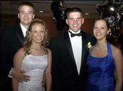 From left, Brian Jones, Free State High School senior; Cicely Reusch, Lawrence High School senior; Travis Shinn, Lawrence, and Jill VanCovern, LHS senior, attend the LHS prom. The event was May 10 in the Kansas Union Ballroom.