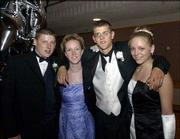 "From left, William Haney, Free State High School senior; Kristen Stetler, Lawrence High School senior; Brandon Butler, Lawrence, and Cassie Strickland, LHS senior, pose for a picture during the LHS prom. The theme of the May 10 event was ""Evening Among the Stars."" It was in the Kansas Union Ballroom."
