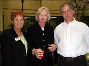 Shirley Martin Smith, left, Jean Milstead and Scott Robinson enjoy refreshments before the Lawrence Memorial Hospital Report to the Community Reception. The event was May 7 at the hospital.