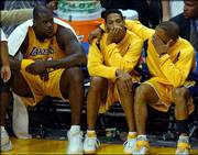 Los Angeles' Robert Horry, center, is consoled by teammate Derek Fisher, right, as they and Shaquille O'Neal sit on the bench during the closing minutes of Game 6 against San Antonio. The Spurs denied the Lakers a chance at winning their fourth straight NBA championship, clinching their Western Conference semifinal series 4-2 with Thursday's 110-82 victory in Los Angeles.
