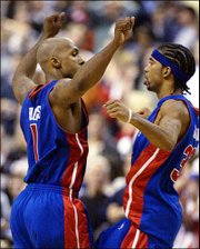 Detroit's Chauncey Billups, left, and teammate Richard Hamilton celebrate their victory over Philadelphia. The Pistons won Game 6 of the Eastern Conference semifinals, 93-89, Friday in Philadelphia to win the best-of-seven series 4-2.