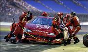 Bill Elliott's crew performs a pit stop during qualifying for The Winston. Elliott won the pole for tonight's NASCAR all-star race with an average speed of 131.502 mph for three laps, including the pit stop, at Lowe's Motor Speedway in Concord, N.C.
