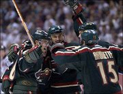 Minnesota's Andrew Brunette (15) is greeted by teammates after his first-period goal against Anaheim. The Wild's first -- and only -- goal of the Western Conference finals gave them a short-lived lead, but the Mighty Ducks won Game 4, 2-1, Friday in Anaheim, Calif., to advance to the Stanley Cup finals.