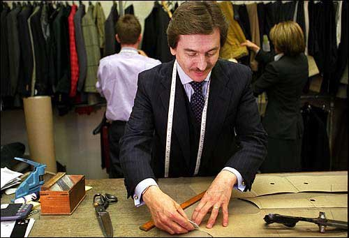 Photo: TERRY HASTE MEASURES AND CUTS material at Huntsman, which ...