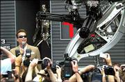 "Arnold Schwarzenegger poses next to a robot for the promotion of his new film ""Terminator 3,"" directed by American Jonathan Mostow, on the sideline of the 56th Film Festival in Cannes, France. Saturday&squot;s appearance was for advance publicity; the film will not be shown at Cannes."