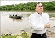 Former Gov. Mike Hayden, at a North Lawrence boat dock, is part of an effort to coordinate the state's water policies. Hayden, Wildlife and Parks secretary, leads a team dealing with water issues including recreation, irrigation and other uses.