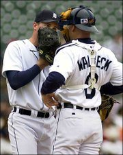 Detroit catcher Matt Walbeck, right, talks to starting pitcher Mike Maroth in the fourth inning of the Tigers' 6-2 loss to Seattle. Maroth fell to 0-9 on the season Sunday in Detroit.