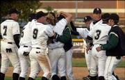 Free State High's baseball team celebrates after beating Lawrence High. The Firebirds won their Class 6A baseball regional championship, 5-1, Tuesday at FSHS Field. Free State advanced to the state tournament May 30 in Maize.