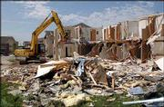 Workers for LRM industries begin demolishing part of Aberdeen South apartments, 4700 W. 27th St. A tornado struck the complex May 8.