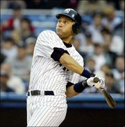 New York's Derek Jeter hits a solo home run to lead off the bottom of the first inning against Boston. The Yankees snapped an eight-game home losing streak with an 11-3 victory Tuesday agaisnt the Red Sox in New York.