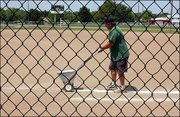 Mark Ice, Lawrence spreads lime on the 4-H middle fields at the Douglas County 4-H Fairgrounds, 2110 Harper St. He was preparing for baseball games to be played later Wednesday.