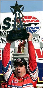 Driver Joe Nemechek celebrates a victory in the Grand National's O'Reilly 300. Nemechek won the race March 29 in Forth Worth, Texas.
