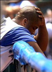 Kansas City's Ken Harvey reacts in the Royals' dugout after grounding out. Seattle defeated Kansas City, 5-2, Wednesday in Kansas City, Mo.