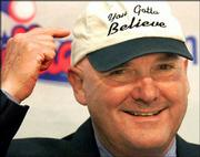 "Former pitcher Tug McGraw shows off his hat, which says, ""You Gotta Believe."" McGraw, who had surgery March 18 in Tampa, Fla., to remove a tumor that extended to both sides of his brain, thanked his supporters Thursday during a news conference at Philadelphia&squot;s Veterans Stadium."