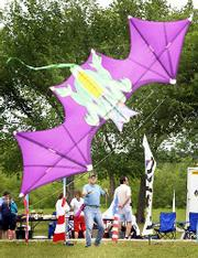 "Doug Hoffman, Olathe, maneuvers a four-string kite called ""Beautiful Evil."
