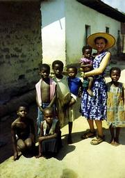 "Lawrence native Tanya Shaffer pals around with children in Afranguah, Ghana, during her trip to the West African country in the early 1990s. Shaffer, who lives in Berkeley, Calif., will sign copies of her book about the trip, ""Somebody&squot;s Heart is Burning: A Woman Wanderer in Africa,"" on Tuesday at the Lawrence Jewish Community Center, 917 Highland Drive."