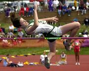 free state high's sam frisbie clears the 5-foot-2 bar during the Class 6A girls high jump. Frisbie won the event Saturday at the Kansas state meet in Wichita.
