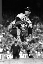 milwaukee braves pitcher warren spahn fires from the mound in a World Series game in this Oct. 5, 1958 file photo at New York's Yankee Stadium. Spahn started 665 games and completed 382 of them, the most by any left-hander in history.