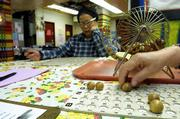 Clementina Valez, 78, checks her cards as numbers are called during a game of bingo at the Henry Street Settlement Senior Services Center on New York's Lower East Side.