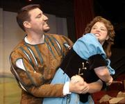 "MPetrucchio, portrayed by Curtis Marsh, struggles with Kate, played by Sarah Young, in a scene from ""Kiss Me Kate."" The Cole Porter musical opens Friday and runs through June 22 at the Lawrence Community Theatre, 1501 N.H."