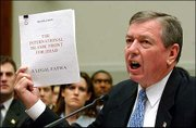Atty. Gen. John Ashcroft holds a translated copy of a plan written by the International Islamic Front for Jihad as he testified before the House Judiciary Committee on Capitol Hill. Ashcroft asked for expanded powers to hold suspected terrorists.