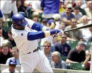 Chicago's Sammy Sosa delivers a run-scoring single in the first inning. Sosa and the Cubs defeated Tampa Bay, 8-1, Thursday in Chicago.