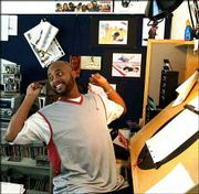 "Animator Bruce Smith, executive producer and creator of the Disney Channel&squot;s ""The Proud Family,"" stretches at his drawing desk at his studio in Glendale, Calif. ""The Proud Family"" is an animated sitcom that follows the adventures of Penny Proud, a 14-year-old African-American girl, and her family."