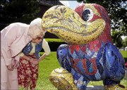 Rowena Pine, Lawrence, left, and her daughter Penny Hemphill, Overland Park, get a close-up look at the mosaic patter on 'Chip Off the Old Hawk,' at 15th Street and Kasold Drive. The women toured the Jayhawks on Parade sculptures with other family members after church and lunch Mother's Day, May 11.