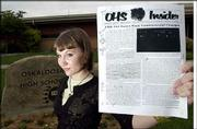 Lacey Hanson, a recent Oskaloosa High School graduate, was at the center of a censorship controversy involving her school paper and the school's principal. Hanson, who will study broadcast journalism next fall at the University of Missouri, is shown outside the school holding the version of the paper edited by the principal.