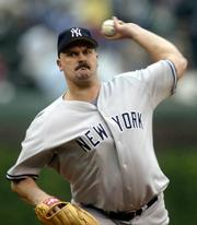 The Yankees' David Wells delivers against the Cubs. Wells pitched 72¼3 innings in New York's 5-3 victory Friday in Chicago.