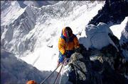 Former New Mexico Gov. Gary Johnson negotiates the Hillary Step on his way to the summit of 29,035-foot Mount Everest.