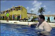 "Angel Alonzo relaxes in the pool at the Freedom Paradise resort south of Cancun, Mexico. The resort bills itself as the first ""size friendly"" beach spot built to accommodate large people."