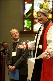 Retiring Bishop Douglas Theuner, right, introduces the Rev. V. Gene Robinson to the Episcopal Church in Concord, N.H. New Hampshire Episcopalians elected Robinson, an openly gay man, as their next bishop.