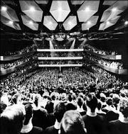 The New York Philharmonic performs in September 1962 before an opening-night audience at New York's Lincoln Center. The orchestra announced Monday it would return to Carnegie Hall where it had previously resided for 71 years, citing Carnegie's celebrated acoustics as a key reason for its decision.