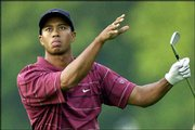Tiger Woods gestures as he watches a shot on the 13th hole of the 2002 U.S. Open. Starting Thursday at Olympia Fields, Woods will try to win his third U.S. Open in four years, something only two other players in history have accomplished.