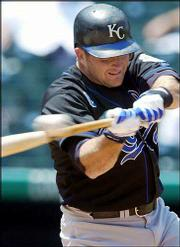 Kansas City's Mike Sweeney connects for a grand slam. Sweeney's homer came in the first game of a doubleheader Saturday against Colorado in Denver. The Royals won the first game, 13-11, and the second game, 9-5.
