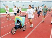 "Isabella Hedges and her daughter, Kris, run during the last day of Red Dog&squot;s Dog Days in this file photo. The summer conditioning program, run by Don ""Red Dog"" Gardner, is dedicated to helping high school athletes and adults stay in shape."