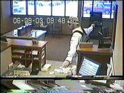 Police have released photos from the bank security cameras.