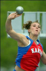 KU freshman Abby Emsick hurls the shot at the Kansas Relays earlier this season. Emsick finished in sixth place at the Relays in April at Memorial Stadium.