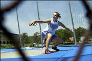 Kansas University freshman Abby Emsick practices throwing the discus. Emsick has qualified for the 2003 NCAA championships that start Wednesday in Sacramento, Calif. Emsick practiced last Wednesday at KU.