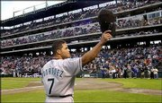 Marlins catcher Ivan Rodriguez acknowledges cheers from fans at The Ballpark in Arlington. Rodriguez returned to Texas for the first time as a member of the Marlins. Rodriguez played for the Rangers from 1991 until he joined Florida prior to this season. The Marlins blanked the Rangers, 8-0, Friday night in Arlington, Texas.