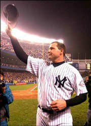 New York's Roger Clemens waves to the crowd after claiming his 300th career victory. The Yankees defeated St. Louis, 5-2, Friday night in New York. Clemens also became just the third pitcher to record 4,000 career strikeouts.