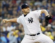 New York's Roger Clemens delivers against St. Louis. Clemens won his 300th game Friday at New York and became just the third pitcher in major league history to record 4,000 strikeouts.