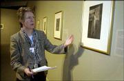 "Anne Verplanck, curator of prints and paintings at Winterthur Museum in Winterthur, Del., talks about a photograph titled ""Constance,"" right, taken by sisters Frances and Mary Allen. The photograph is among those by the Allen sisters on exhibit at the museum through Sept. 7."