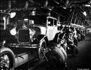 A Ford Model A goes through the assembly line at the Rouge plant in Dearborn, Mich. The picture was taken in 1928.