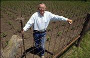 "Paul Heitzman planted a small plot of check-rowed corn on his farm between Eudora and DeSoto. Heitzman said he wanted to plant his ""field of dreams"" because he remembered seeing beautiful rows of corn in Iowa."