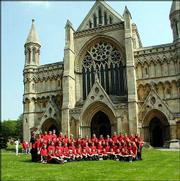 The Lawrence Children's Choir poses for a group photo in front of St. Albans Cathedral. The group spent a week in late May/early June singing at historic venues in London. The trip had been scheduled for the spring of 2002 but was put on hold after the events of Sept. 11, 2001.
