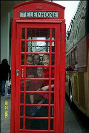 Lawrence Children's Choir members, from left, Jennifer Taylor, Kristina Taylor, Natalie Rabiola and Lindsay Gauthier clown around in a London phone booth during the choir's tour in late May/early June. The choir sang at St. Martin in the Fields, St. Albans Cathedral and Windsor Parish Chapel during the trip, which originally was scheduled for the spring of 2002 but was rescheduled after the Sept. 11, 2001, terrorist attacks made parents apprehensive about world travel.