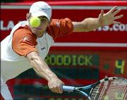 Andy Roddick returns a shot to Andre Agassi. Roddick defeated Agassi in the Queen's Club semifinals Saturday in London.