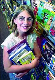 Kajsa Mullenix, 11, is being rewarded with a trip to Disneyland for her love of reading, academic excellence and volunteerism. Mullenix's family will travel to Los Angeles in July for five days of fun.